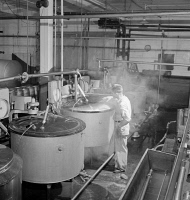 0324421 © Granger - Historical Picture ArchiveVERMONT: CREAMERY, 1941.   Pasteurizing units at the United Farmers' Cooperative Creamery in Sheldon Springs, Vermont. Photograph by Jack Delano, 1941.