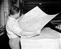 0123212 © Granger - Historical Picture ArchiveCENSUS PRINTING, 1937.   A printer at the Government Printing Office inspecting a questionnaire for the Unemployment Census. Photograph, 7 October 1937.