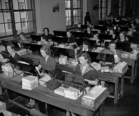 0527576 © Granger - Historical Picture ArchiveTABULATING MACHINES, c1940.   Women operating tabulating machines, possibly processing data from the 1940 census. Photograph, c1940.