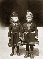0527680 © Granger - Historical Picture ArchiveELLIS ISLAND: GIRLS, c1910.   Portrait of Sami girls from Lapland at Ellis Island. Photograph by Augustus Sherman, c1910.