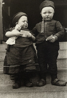 0527690 © Granger - Historical Picture ArchiveELLIS ISLAND: CHILDREN, c1910.   Portrait of a young brother and sister from Marken, the Netherlands, at Ellis Island. Photograph by Augustus Sherman, c1910.