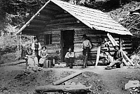 0176318 © Granger - Historical Picture ArchiveOREGON: LOG CABIN, c1900.   Settlers on the frontier in northeastern Oregon posing in front of their log cabin home. Photographed c1900.
