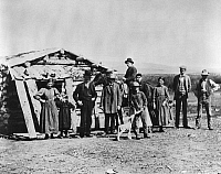 0184162 © Granger - Historical Picture ArchiveIDAHO: SETTLERS, c1882.   A group of settlers standing outside a log cabin in American Falls, Idaho. Photographed c1882.