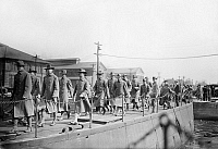0123140 © Granger - Historical Picture ArchiveMARINES DEPARTING, 1913.   U.S. Marines embarking for Guantanamo, Cuba, at the Philadelphia Naval Shipyard on League Island at Philadelphia, Pennsylvania, in response to the Mexican Revolution, February 1913.