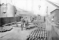 0123420 © Granger - Historical Picture ArchiveMARINE AMMUNITION, 1913.   The transfer of 8-inch mortar shells from the deck of the armored cruiser USS 'Brooklyn' at the Philadelphia Naval Shipyard on League Island at Philadelphia, Pennsylvania, to be shipped with a U.S. Marine contingent to Guantanamo, Cuba, in response to the Mexican Revolution, February 1913.