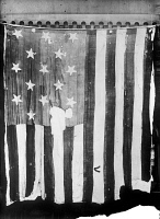 0382888 © Granger - Historical Picture ArchiveTHE STAR SPANGLED BANNER.   The 15-star American flag that flew over Fort McHenry in Baltimore Harbor, September 1814, and inspired Francis Scott Key to write 'The Star Spangled Banner.' Photograph, 1914.