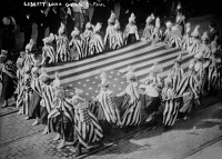 0621878 © Granger - Historical Picture ArchivePARADE: LIBERTY LOAN GIRLS.   Liberty Loan girls carrying an American flag in a parade in St. Paul, Minnesota. Photograph, 1917.