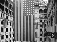 0621882 © Granger - Historical Picture ArchiveAMERICAN FLAG, c1925.   American flag hanging in the Old U.S. Post Office in Washington, D.C. Photograph, c1925.