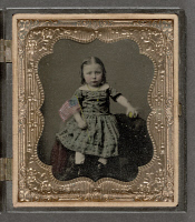 0621939 © Granger - Historical Picture ArchiveCHILD, c1865.   Unidentified girl holding an American flag and a ball. Hand-colored tintype, c1865.
