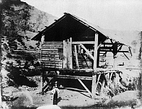 0116263 © Granger - Historical Picture ArchiveSUTTER'S MILL, c1850.   James Marshall, prospector, standing in front of Sutter's Mill, where he discovered gold, Coloma, California. Photograph, c1850.
