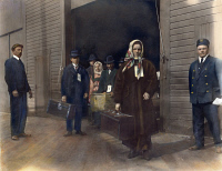 0009659 © Granger - Historical Picture ArchiveEUROPEAN IMMIGRANTS   leaving Ellis Island. Oil over a photograph, c. 1900.