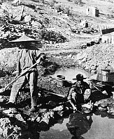 0086827 © Granger - Historical Picture ArchiveCHINESE GOLD MINERS, c1850.   Chinese immigrant miners during the California Gold Rush. Photographed c1850.