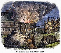 0102437 © Granger - Historical Picture ArchiveNATIVE AMERICAN ATTACK, 1675.   Native Americans attacking a Massachusetts village (Brookfield or Deerfield) during King Philip's War, 1675. Wood engraving, American, c1829.