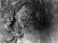 0116218 © Granger - Historical Picture ArchiveCALIFORNIA: MINING, c1922.   A miner looking at the last message left by 47 entombed miners on the side of a 4,350 foot drift in the Argonaut gold mine, Jackson, California. Photograph, c1922.