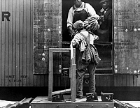 0118567 © Granger - Historical Picture ArchiveALABAMA: BANANAS, c1937.   Workers loading bananas onto a railroad freight car in Mobile, Alabama. Photographed by Arthur Rothstein, c1937.