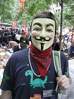 0216374 © Granger - Historical Picture ArchiveOCCUPY WALL STREET, 2011.   A protester at the Occupy Wall Street encampment in Zuccotti Park, New York City, wearing a Guy Fawkes mask, made popular by the graphic novel 'V for Vendetta,' and which has become associated with various anti-establishment activist groups. Photograph, October 2011. Full credit: Michael Morrah / Granger, NYC -- All rights reserve