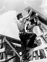 0117924 © Granger - Historical Picture ArchiveNEW DEAL: C.C.C., 1940.   Worker for the Civilian Conservation Corps climbing up on scaffold erected for assembling a prefabricated building, Appalachia, Virginia, 1940.