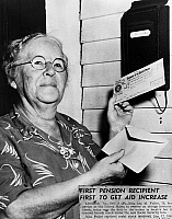 0170282 © Granger - Historical Picture ArchiveSOCIAL SECURITY, 1940.   Ida May Fuller (1874-1975) of Ludlow, Vermont, the first beneficiary under the Social Security system, holding her first check, January 1940.