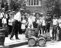 0002821 © Granger - Historical Picture ArchivePROHIBITION, 1920s.   Federal agent destroying contraband kegs of alcohol in Chicago during the 1920s.