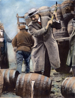 0059852 © Granger - Historical Picture ArchivePROHIBITION.   Philadelphia public safety director Butler destroying kegs of bootleg beer, the contents of which had been poured into the Schuylkill River. Oil over a photograph, 1924.