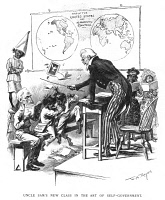 0050176 © Granger - Historical Picture ArchiveSPANISH-AMERICAN WAR, 1898.   The United States, as Uncle Sam the school teacher, corrects the independent behavior of the Philippines (Aguinaldo) and Cuba (Gomez). Cartoon by W.A. Rogers, 1898.