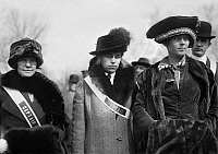 0114935 © Granger - Historical Picture ArchiveSUFFRAGETTES, 1913.   Three suffragettes identified as Mary Bair, Mrs. Albert Wood and Mrs. Richard Burleson, photographed at the women's suffrage parade held in Washington, D.C., 3 March 1913.