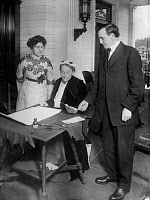 0166792 © Granger - Historical Picture ArchiveOREGON: WOMEN'S SUFFRAGE.   Abigail Scott Duniway signing Oregon's Equal Suffrage Proclamation on 30 November 1912, as Governor Oswald West and Viola Coe look on.