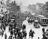 0186647 © Granger - Historical Picture ArchiveWASHINGTON, D.C.: SUFFRAGE.   Suffragettes arriving from New York, parading up Pennsylvania Avenue after marching to the Capitol. Photographed looking toward the Capitol along Pennsylvania Avenue between 4th and 5th Streets. A film crew is visible at lower right. Photograph, c1917.