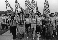 0527162 © Granger - Historical Picture ArchiveWOMEN'S CONFERENCE, 1977.   Torch relay runners entering Houston, Texas from Seneca Falls, New York, in advance of the National Women's Conference. Susan B. Anthony II, Bella Abzug, Betty Friedan, and Billie Jean King accompanied the runners Sylvia Ortiz, Peggy Kokernot, and Michelle Cearcy for the final mile. Photograph, November 1977.