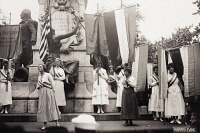 0528166 © Granger - Historical Picture ArchiveSUFFRAGETTES, 1918.   Lucy Branham burning a speech by President Woodrow Wilson during a National Woman's Party pageant at the Lafayette statue in Washington, D.C. Photograph, 16 September 1918.