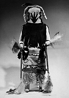 0173161 © Granger - Historical Picture ArchiveZUNI KACHINA DOLL.   Salamopea Anahoho Shikjana, a Zuni spirit or Kachina. Carved and painted wooden doll from Zuni Pueblo, New Mexico, late 19th century, with a handprint for a face, dressed in cotton cloth with a fringed skirt, and carrying a feathered wand in each hand. Height: 14 3/4 in.