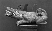 0174445 © Granger - Historical Picture ArchiveHAIDA SEA WOLF.   Haida wooden figure of the sea wolf Wasgo with a salmon in its mouth, from British Columbia, Canada.