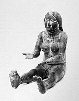 0174525 © Granger - Historical Picture ArchiveKWAKIUTL ART: MAIDEN.   Kwakiutl wooden figure of a seated praying maiden, from British Columbia, Canada, 19th century or earlier. Height: 16 in.