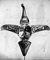 0175257 © Granger - Historical Picture ArchiveKWAKIUTL MASK.   Painted wooden double mask of the Kwakiutl Native Americans of British Columbia, Canada, representing an eagle when closed, and the eagle's spirit in human form, together with a grizzly bear (left and right) and a killer whale (top and bottom), when open.