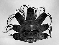 0175263 © Granger - Historical Picture ArchiveNATIVE AMERICAN FRONTLET.   Carved and painted wooden frontlet from a chief's ceremonial headdress, with projections representing the sun's rays, adorned with human hair, and teeth of inlaid snail shells. Niska, from the Nass River Valley in British Columbia, Canada, c1875. Height: 11 1/2 in.