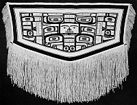 0175368 © Granger - Historical Picture ArchiveALASKA: CHILKAT BLANKET.   Chilkat dancing blanket with diving whale design, made of mountain goat wool and cedar bark fiber. Tlingit, southeastern Alaska. Length: 70 in.