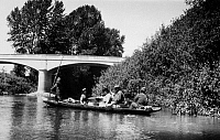 0173033 © Granger - Historical Picture ArchiveWASHINGTON: CANOE, 1921.   Duwamish Native Americans transporting passengers in a shovel-nose canoe on the Duwamish River, in western Washington State. Photographed by Thomas T. Waterman, 1921.