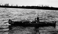 0173034 © Granger - Historical Picture ArchiveCANADA: BIRCHBARK CANOE.   A Slavey Native American man paddling a birchbark canoe on the Mackenzie River, in the Northwest Territories in Canada. Photograph, early to mid-20th century.