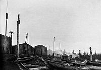 0173039 © Granger - Historical Picture ArchiveKWAKIUTL VILLAGE, 1894.   A view of a Kwakiutl village at Port Rupert, British Columbia, Canada, showing wood plank houses, blanket poles (where piles of blankets were placed during potlatch ceremonies), and dugout canoes in the foreground. Photographed by O.C. Hastings, late 1894.