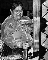 0259091 © Granger - Historical Picture ArchiveARIZONA: NAVAJO WEAVER.   Faye Yazzie, a Navajo weaver, working at a loom in Arizona. Photograph by Fred Mang, Jr., c1965.