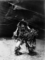 0115980 © Granger - Historical Picture ArchiveNAVAJO RITUAL, c1905.  Navajo man dressed in hemlock boughs and mask associated with the rain god Tonenili, the 'Water Sprinkler.' Photographed by Edward S. Curtis. c1905.