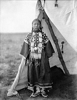 0118239 © Granger - Historical Picture ArchiveSIOUX GIRL, c1905.   Rosa Lame Dog, a Sioux Native American girl, standing at the entrance to a tipi on the Great Plains. Photographed by Edward S. Curtis, c1905.