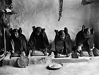 0109423 © Granger - Historical Picture ArchiveHOPI GRINDING GRAIN, c1906.   Four young Hopi women in Arizona grinding grain at the mealing trough. Photographed by Edward S. Curtis, c1906.