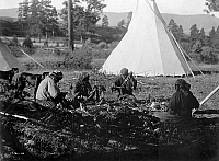 0113834 © Granger - Historical Picture ArchiveMEAT PREPARATION, c1910.   Four Flathead women of the Pacific Northwest preparing meat. Photograph by Edward Curtis, c1910.