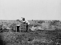 0117816 © Granger - Historical Picture ArchiveSIOUX COOKING, c1911.   High Bear, a Brulé Sioux Native American man on the Rosebud Reservation in South Dakota, cooking by throwing heated stones into a beef-stomach container. Photographed c1911.