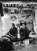 0173430 © Granger - Historical Picture ArchiveHOPI WOMEN, 1901.   Two Hopi women inside a home at a pueblo in northeastern Arizona. Photographed by William H. Simpson and Carl N. Werntz, 1901.
