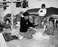 0186419 © Granger - Historical Picture ArchiveNAVAJO FAMILY, c1970.   Rose Yazzie with her children, spinning wool in Canyon de Chelly, Arizona. Photograph by Fred Mang Jr., c1970.