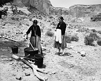 0259102 © Granger - Historical Picture ArchiveARIZONA: NAVAJO WEAVERS.   12-year-old Navajo Roslyn Yazzie and her mother Rose, dyeing wool yarn to be woven into a rug. Photographed in Arizona by Fred Mang, Jr., c1965.