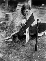 0324237 © Granger - Historical Picture ArchivePREPARING CEDAR BARK, c1914.   A 'Nak'waxda'xw woman preparing cedar bark, possibly in British Columbia. Photograph by Edward S. Curtis, c1914.