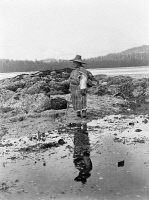 0324238 © Granger - Historical Picture Archive'NAK'WAXDA'XW WOMAN, c1910.   A 'Nak'waxda'xw woman standing on the beach in British Columbia. Photograph by Edward S. Curtis, c1910.
